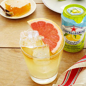 cocktail with fruit and sanpellegrino grapefruit beverage
