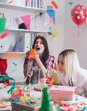 Two girls having a party and drinking Sanpellegrino fruit beverages