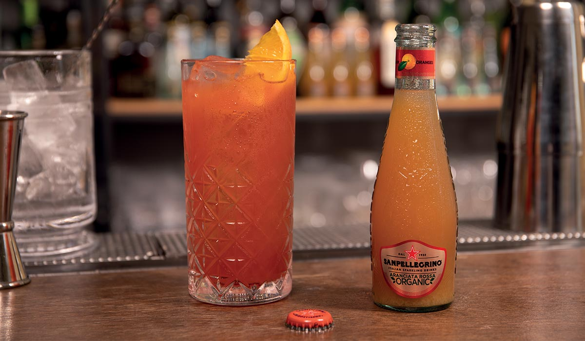 Sanpellegrino Aranciata Rossa Organic bottle with a Blood e Sand Cocktail
