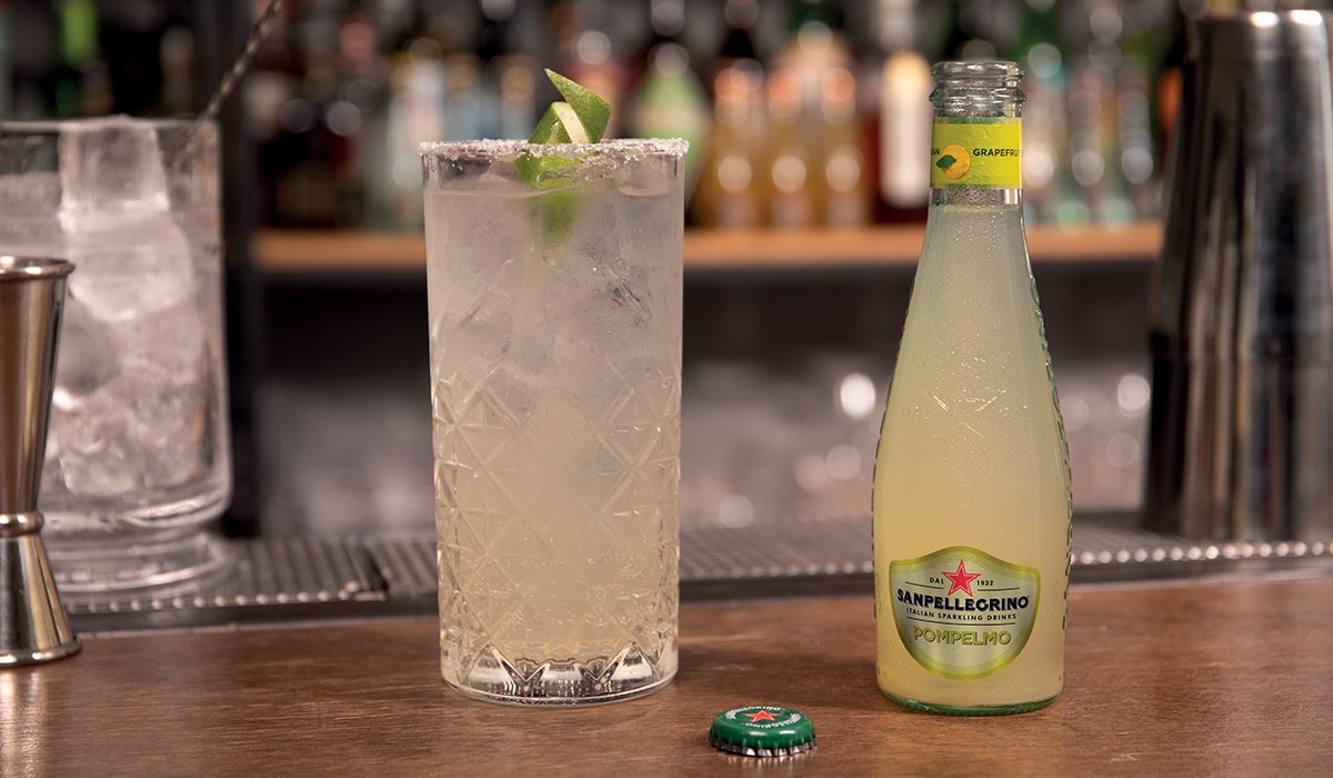 Sanpellegrino Paloma Cocktail with a bottle of Sanpellegrino Pompelmo